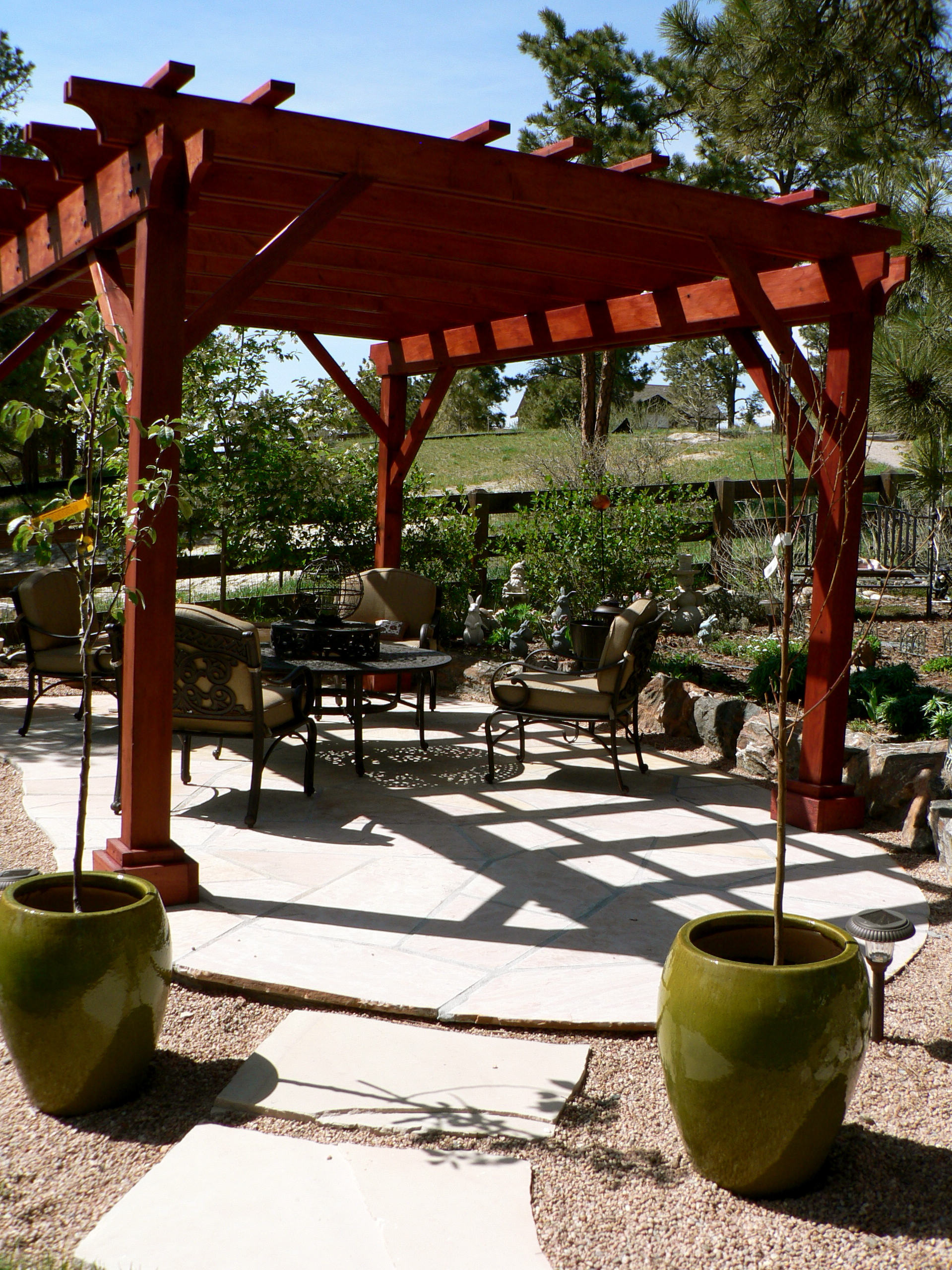 Red stained pergola | Craftsman Outdoor Living